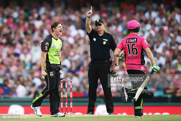 Shane Watson of the Thunder celebrates taking the wicket of Daniel Hughes of the Sixers during the Big Bash League match between the Sydney Sixers...