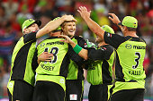Shane Watson of the Thunder celebrates with team mates after taking the wicket of Sean Abbott of the Sixers during the Big Bash League match between...
