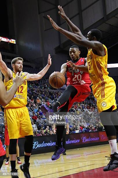 Shane Whittington and Rakeem Christmas of the Fort Wayne Mad Ants battle Bruno Caboclo 2of the Raptors 905 during their NBDL game at Memorial...