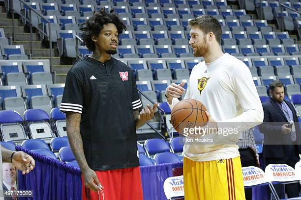 Shane Whittington of the Fort Wayne Mad Ants chats with Lucas Nogueira of the Raptors 905 prior to their NBDL game at Memorial Coliseum November 14...