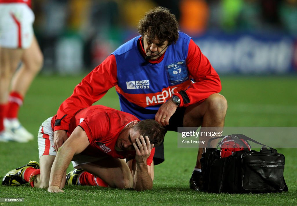 <a gi-track='captionPersonalityLinkClicked' href=/galleries/search?phrase=Shane+Williams&family=editorial&specificpeople=206777 ng-click='$event.stopPropagation()'>Shane Williams</a> (L) of Wales lies dejected as he is comforted by team physio Mark Davies during the 2011 IRB Rugby World Cup bronze final match between Wales and Australia at Eden Park on October 21, 2011 in Auckland, New Zealand.