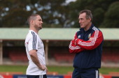 Shane Williams who has been selected to play for the Lions against the Brumbies talks to the Lions backs coach Rob Howley during the British and...