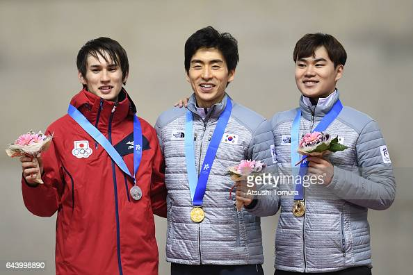 Shane Williamson of Japan SeungHoon Lee of South Korea and MinSeok Kim of South Korea pose on the podium during award ceremony for the speed skating...