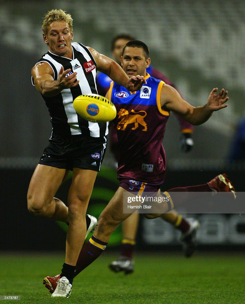 Shane Woewodin #2 for Collingwood contests with Chris Johnson #2 for Brisbane during the AFL Second Qualifying Final between the Collingwood Magpies and the Brisbane Lions at the Melbourne Cricket Ground on September 6, 2003 in Melbourne, Australia.