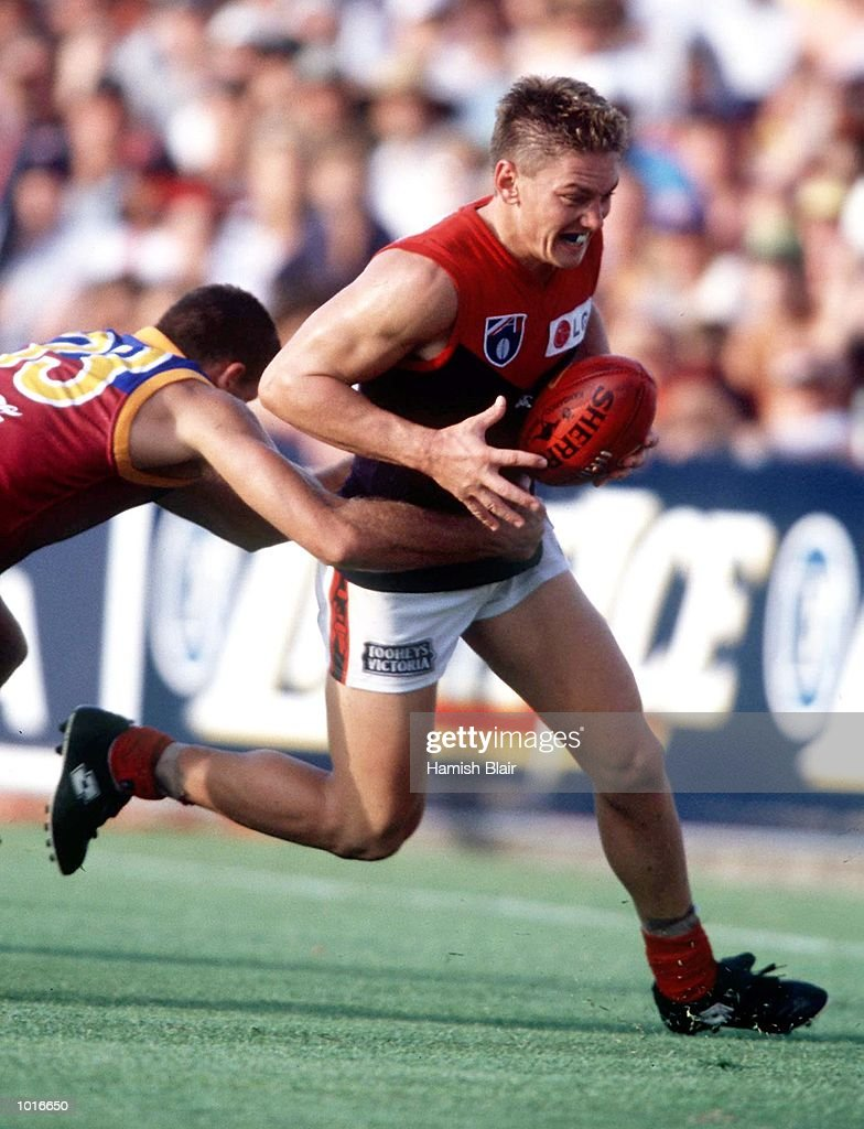 Shane Woewodin of Melbourne is caught with the ball, in the match between the Brisbane Lions and Melbourne, during round three of the AFL season, played at the GABBA, Brisbane, Australia. Mandatory Credit: Hamish Blair/ALLSPORT