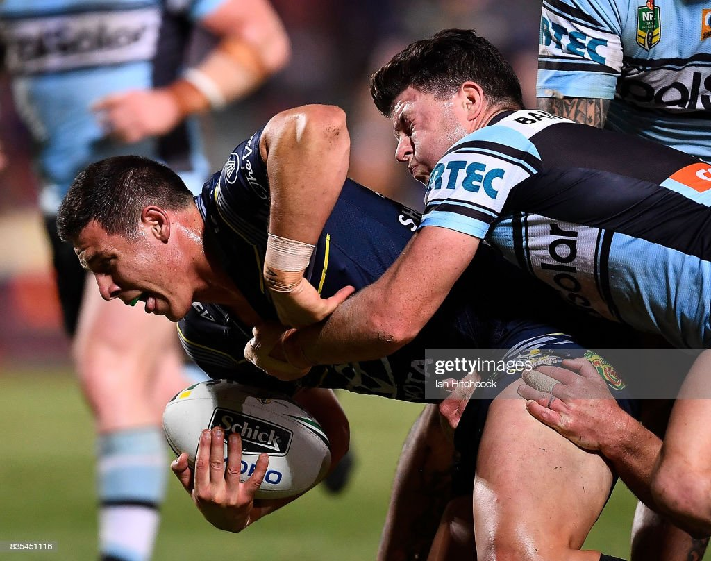 Shane Wright of the Cowboys is tackled by Chad Townsend of the Sharks during the round 24 NRL match between the North Queensland Cowboys and the Cronulla Sharks at 1300SMILES Stadium on August 19, 2017 in Townsville, Australia.