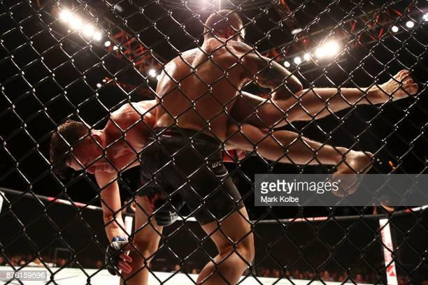 Shane Young of New Zealand is lifted by Alexander Volkanovski of Australia in their catchweight bout during the UFC Fight Night at Qudos Bank Arena...