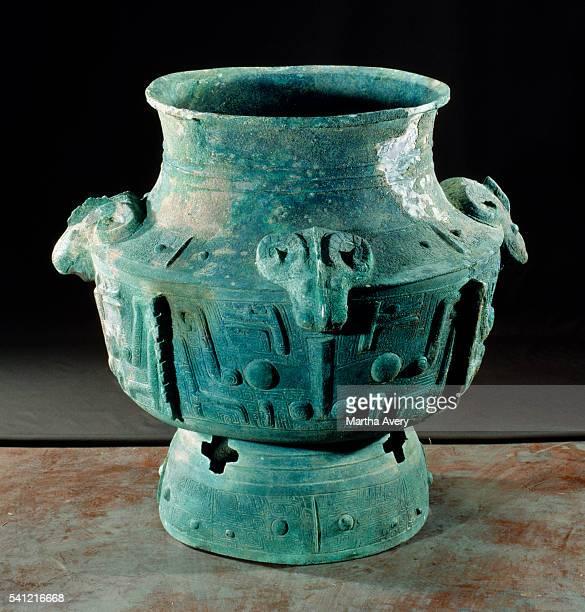 Shang Dynasty Bronze Zun with Ram's Head Motif