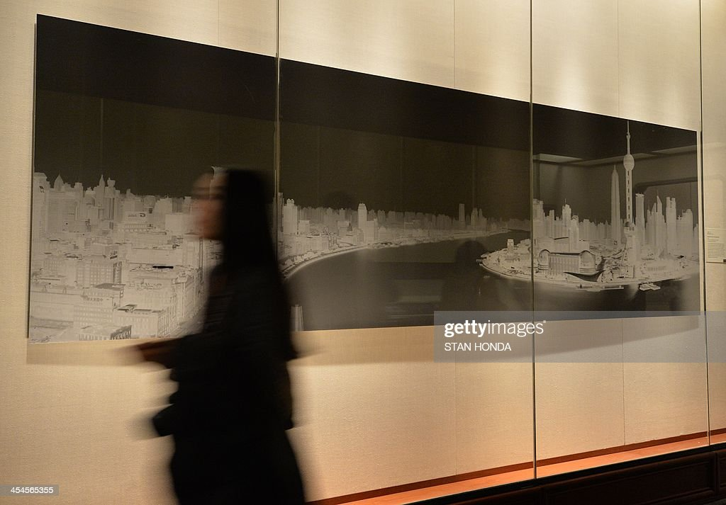 'Shanghai, China, 15-16 October 2004' by Shi Guorui, a photograph created by using a camera obscura, is displayed in the exhibition 'Ink Art: Past as Present in Contemporary China' at the Metropolitan Museum of Art on December 9, 2013 in New York. A major exhibition of 70 pieces of art by 35 contemporary artists born in China goes on view to the public on December 11. AFP PHOTO/Stan HONDA ++RESTRICTED