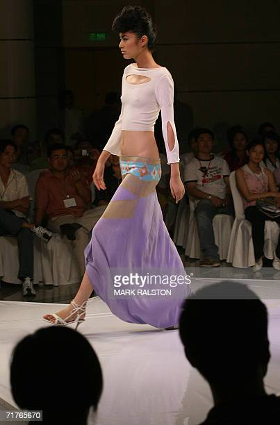A model wears knitwear designed by local Chinese designers for the German fashion label Stoll at a fashion show in Shanghai 01 September 2006 Chinese...