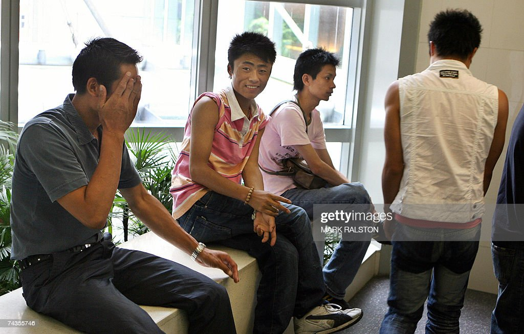 Chinese men loiter in the bathroom of a large department store, which has become the latest hangout for Shanghai's emerging homosexual population, 30 May 2007. China has a gay population estimated in the tens of millions but homosexuality is still a largely taboo subject in the country due to a mix of traditional conservatism and communist prejudice against gays and it was listed as a mental disorder until 2001. AFP PHOTO/Mark RALSTON