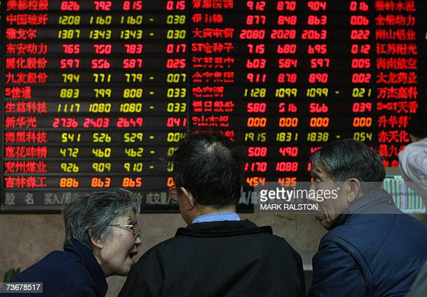 Elderly Chinese investors in front of a stock price board at a private securities firm in Shanghai 23 March 2007 Chinese share prices posted record...