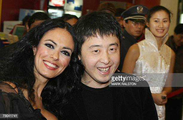 Italian actress Maria Grazia Cucinotta and Chinese film director Jia Zhangke arrive for the Chinese premier of the movie L'Ultimo Bacio at the start...