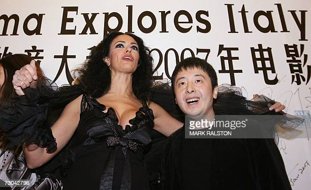 Italian actress Maria Grazia Cucinotta and Chinese film director Jia Zhangke arrives for the Chinese premier of the movie L'Ultimo Bacio at the start...