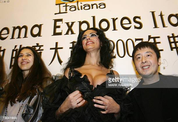 Italian actresses Olivia Magnani and Maria Grazia Cucinotta with Chinese film director Jia Zhangke arrive for the Chinese premier of the movie...