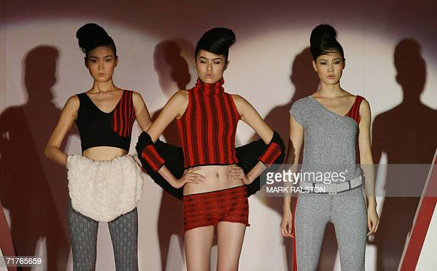 Models wear knitwear designed by local Chinese designers for the German fashion label Stoll at a fashion show in Shanghai 01 September 2006 Chinese...