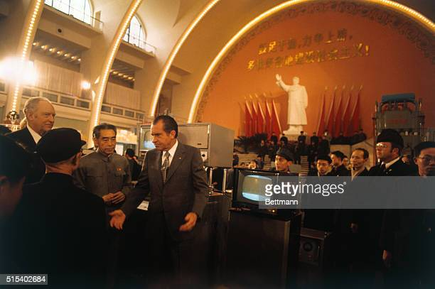 Shanghai China President Nixon gestures as he admires televisions and other equipment being shown in an industrial display in the Shanghai Exhibition...