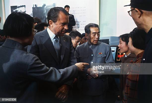 Shanghai China President Richard Nixon with Chinese Premier ChouEnLai as looking at displays and scientific equiptment in the Shanghai Exhibition Hall