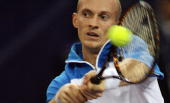 World number three Nikolay Davydenko of Russia plays a backhand stroke during his match against Rafael Nadal of Spain at the USD 445 million Tennis...