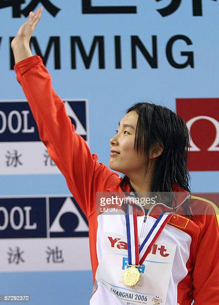 Yang Yu from China with her gold medal after winning the Women's 200 metre freestyle final with a time of 15494 during the final day of the 8th FINA...