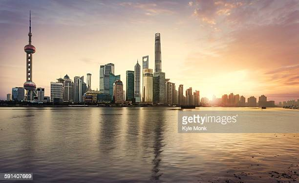 Shanghai city skyline reflecting in waterfront, Shanghai, China