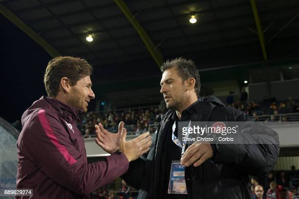 Shanghai coach Andre VillasBoas talks to Tony Popovic of the Wanderers during the AFC Asian Champions League Group Stage match between the Western...