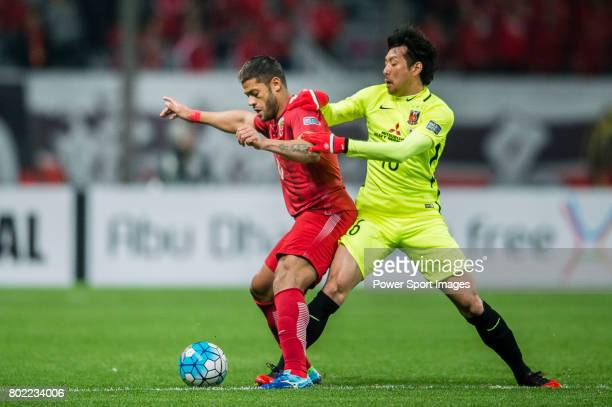 Shanghai FC Forward Givanildo Vieira De Sousa fights for the ball with Urawa Reds Midfielder Aoki Takuya during the AFC Champions League 2017 Group F...