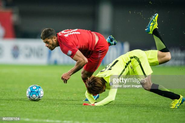 Shanghai FC Forward Givanildo Vieira De Sousa fights for the ball with Urawa Reds Midfielder Komai Yoshiaki during the AFC Champions League 2017...