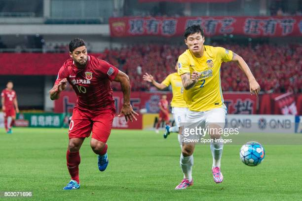 Shanghai FC Forward Givanildo Vieira De Sousa fights for the ball with Jiangsu FC Defender Li Ang during the AFC Champions League 2017 Round of 16...