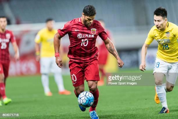Shanghai FC Forward Givanildo Vieira De Sousa fights for the ball with Jiangsu FC Midfielder Yang Xiaotian during the AFC Champions League 2017 Round...