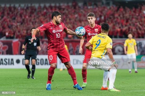 Shanghai FC Forward Givanildo Vieira De Sousa fights for the ball with Jiangsu FC Forward Roger Beyker Martinez during the AFC Champions League 2017...