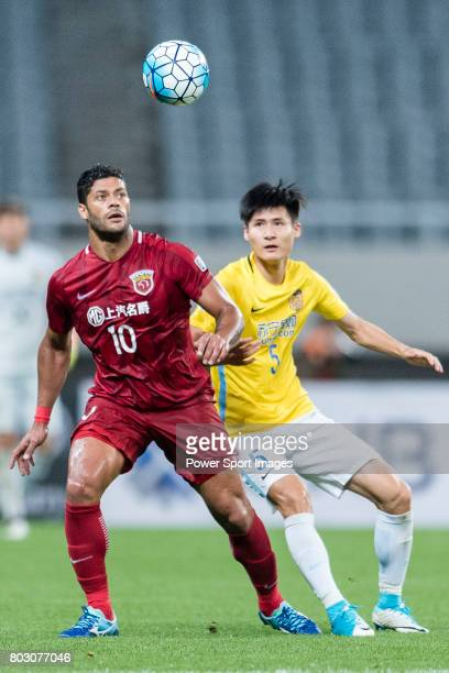 Shanghai FC Forward Givanildo Vieira De Sousa fights for the ball with Jiangsu FC Defender Zhou Yun during the AFC Champions League 2017 Round of 16...