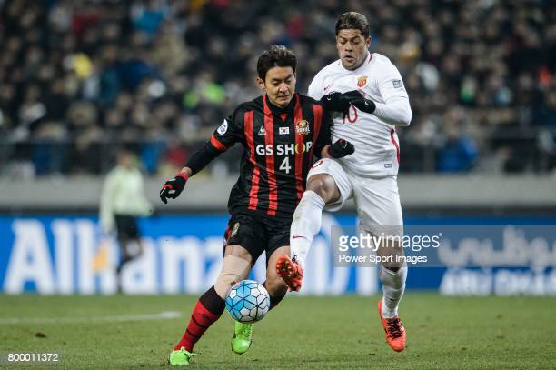 Shanghai FC Forward Givanildo Vieira De Sousa in action against FC Seoul Defender Kim Dong Woo during the AFC Champions League 2017 Group F match...