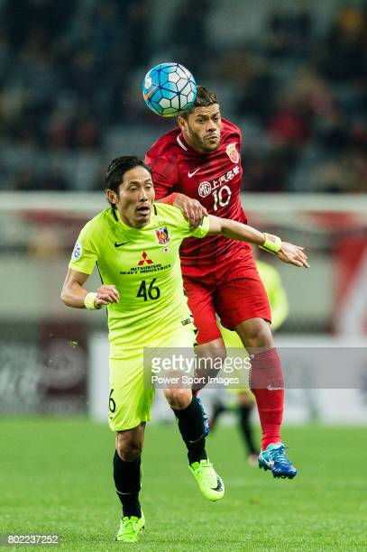 Shanghai FC Forward Givanildo Vieira De Sousa in action against Urawa Reds Defender Moriwaki Ryota during the AFC Champions League 2017 Group F match...