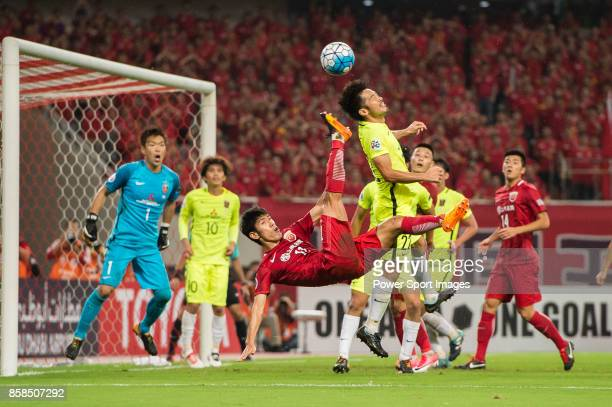 Shanghai FC Forward Lyu Wenjun attempts a bicycle kick while being defended by Urawa Reds Midfielder Abe Yuki during the AFC Champions League 2017...