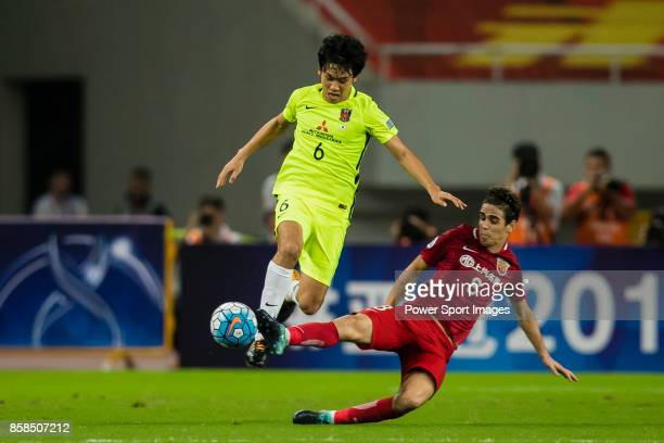 Shanghai FC Forward Oscar Emboaba Junior trips up with Urawa Reds Defender Endo Wataru during the AFC Champions League 2017 SemiFinals match between...