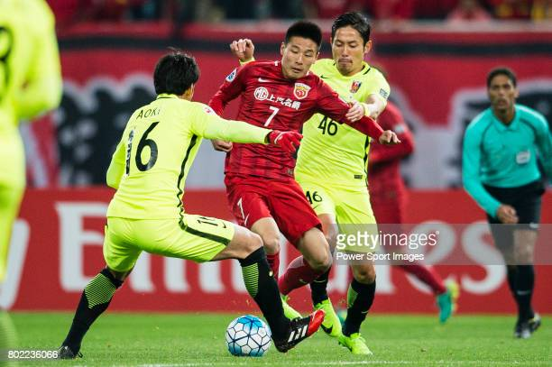 Shanghai FC Forward Wu Lei in action against Urawa Reds Defender Moriwaki Ryota during the AFC Champions League 2017 Group F match between Shanghai...