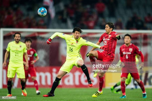 Shanghai FC Midfielder Akhmedov Odil in action against Urawa Reds Midfielder Aoki Takuya during the AFC Champions League 2017 Group F match between...