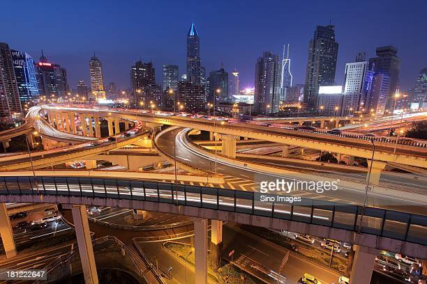 Shanghai, luminous overpass with edifices in the background