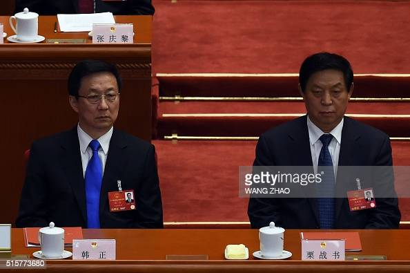 Shanghai Party chief Han Zheng and a member of the Political Bureau of the 18th Communist Party of China Central Committee Li Zhanshu attend the...