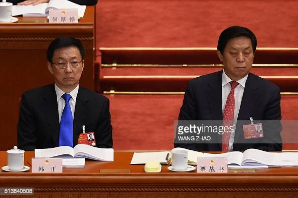 Shanghai Party chief Han Zheng and member of the Political Bureau of the 18th Communist Party of China Central Committee Li Zhanshu attend the...