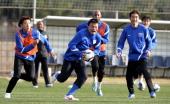 Shanghai Shenhua's French midfielder Nicolas Anelka runs with his teammates during a training session at the Craks Stadium in Betera near Valencia on...