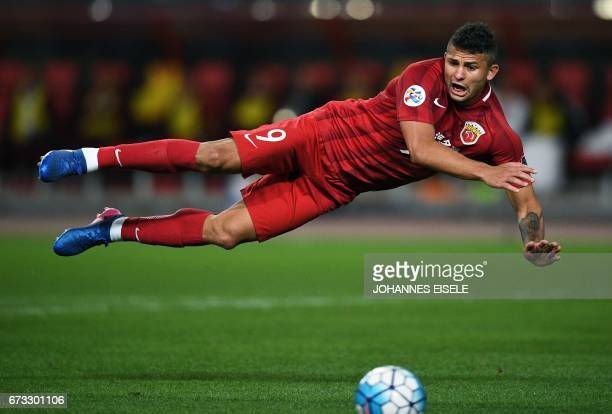 TOPSHOT Shanghai SIPG Brazilian forward Elkeson vies for the ball during the AFC Asian Champions League group match between the Shanghai SIPG and...