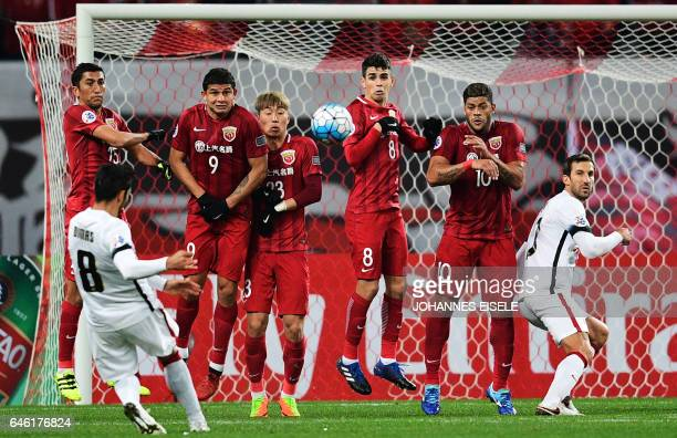 Shanghai SIPG' Brazilian forward Hulk and Brazilian midfielder Oscar attempt to block the ball during the AFC Asian Champions League group football...