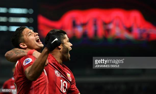 Shanghai SIPG' Brazilian forward Hulk and teammate Elkeson celebrate a goal during the AFC Asian Champions League group football match between...
