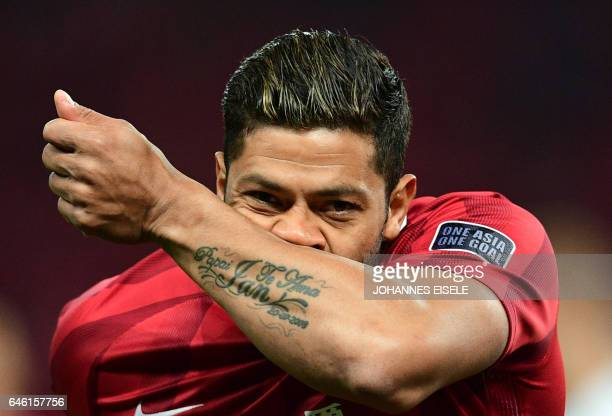 Shanghai SIPG' Brazilian forward Hulk celebrates after scoring during the AFC Asian Champions League group football match between the China's...