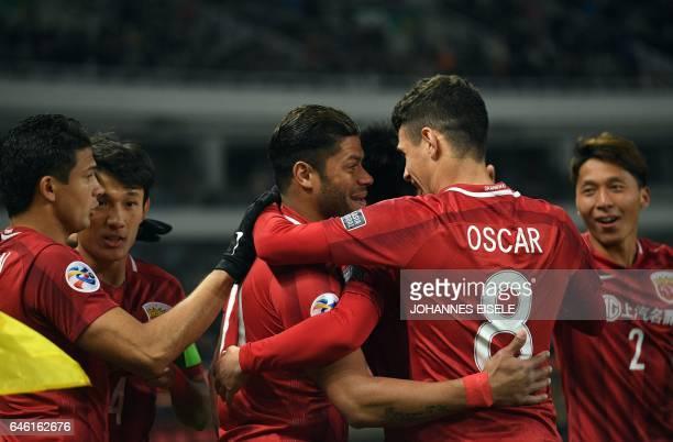 Shanghai SIPG' Brazilian forward Hulk celebrates his goal with Shanghai SIPG' Brazilian midfielder Oscar during the AFC Asian Champions League group...