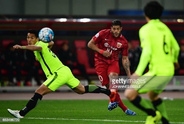 Shanghai SIPG' Brazilian forward Hulk kicks the ball past Urawa Red Diamonds' defender Tomoaki Makinovie during the AFC Asian Champions League group...