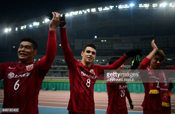 Shanghai SIPG' Brazilian midfielder Oscar and teammates applaud the fans after victory in the AFC Asian Champions League group football match between...