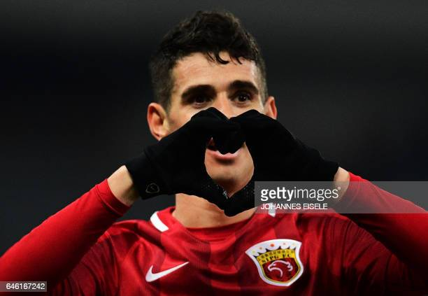 Shanghai SIPG' Brazilian midfielder Oscar celebrates after scoring during the AFC Asian Champions League group football match between the China's...
